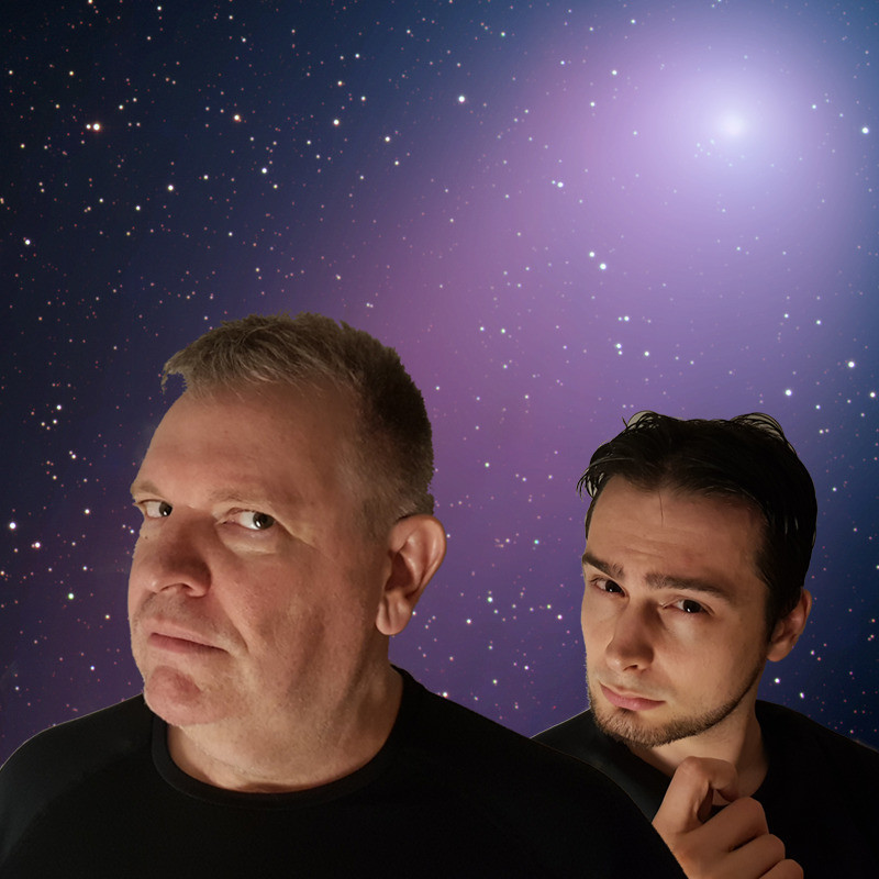 Galactic Trek : Redemption - A photo of two men looking inquisitively ahead. The background depicts the night sky and is purple with small white stars.