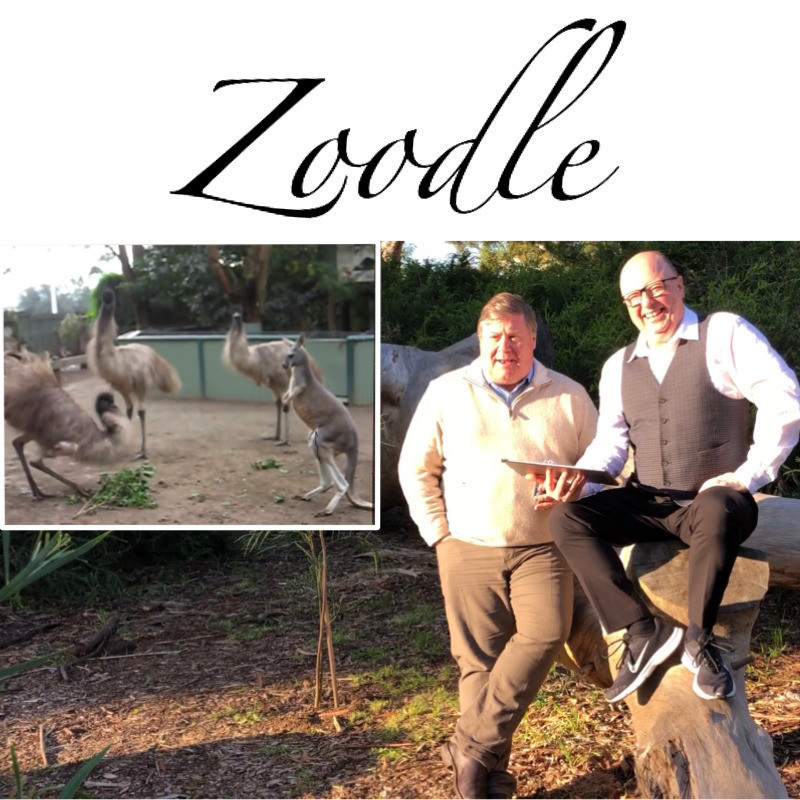 Zoodle in the Pub - Two men are outside in the bush, one sits on a log and is bald, he holds an iPad. The other is wearing a cream jumper. The image of the men is inset with an image of three emus and a kangaroo. The word Zoodle is above them in cursive font.