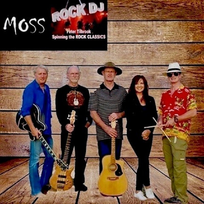 A photo of five people standing. There are three people holding guitars, one person holding a pair of wooden drumsticks, and one person holding nothing. They have been edited onto a wooden background. There is a logo in the top left corner that reads 'MOSS', 'Rock DJ' 'Peter Tilbrook' and 'Spinning the Rock Classics' in white font.