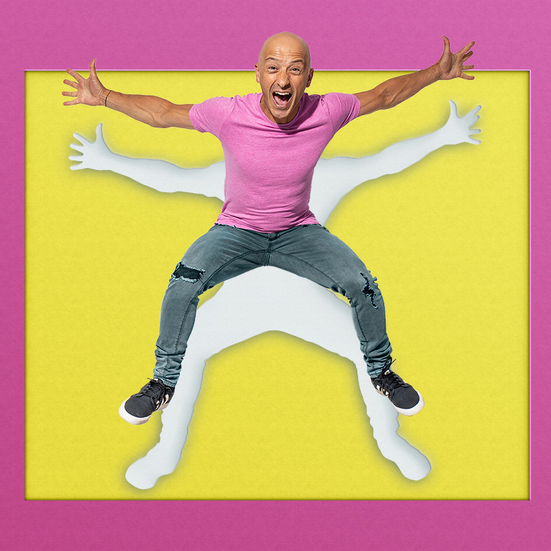 An image of a guy doing a star jump with his arms and legs stretched out. He is wearing a pink t-shirt, grey pants and black sneakers. There is a white outline behind him and the background is yellow and pink.