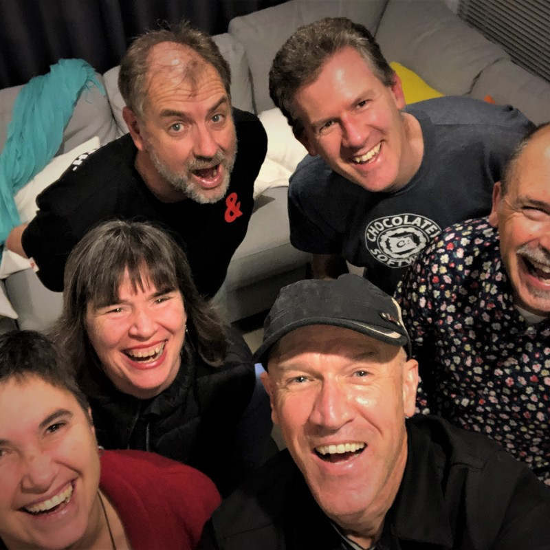 A photo of six people smiling for a selfie.