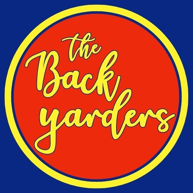 The Backyarders - A logo image of text that reads 'The Back Yarders' in yellow calligraphy font upon a red circle background.