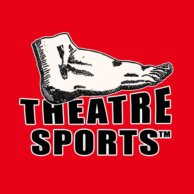 17th Theatresports(TM) Clash of the Titans - A graphic logo of a human foot featured above Theatre Sports™ written in black capital letters on a red background.