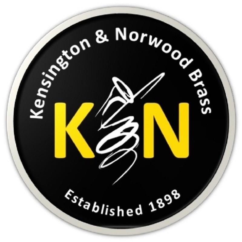 Music from Brassed Off - A circular logo that reads 'Kensington & Norwood Brass' and 'Established 1898' in white font. In the middle of the logo is a large 'K' and 'N' in yellow font and a brief illustration of a brass musical instrument horn in between the letters.