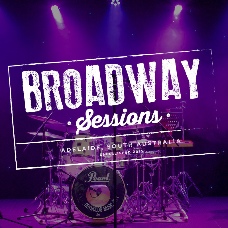 A photograph of a drum kit on stage illuminated with purple lighting. The text on top of the image reads, 'Broadway Sessions' 'Adelaide, South Australia' in white decorative font with a rectangle around it.
