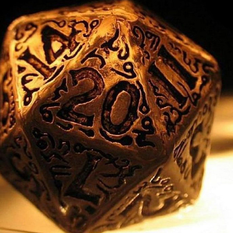 A close up image of a gold 20-sided dice.