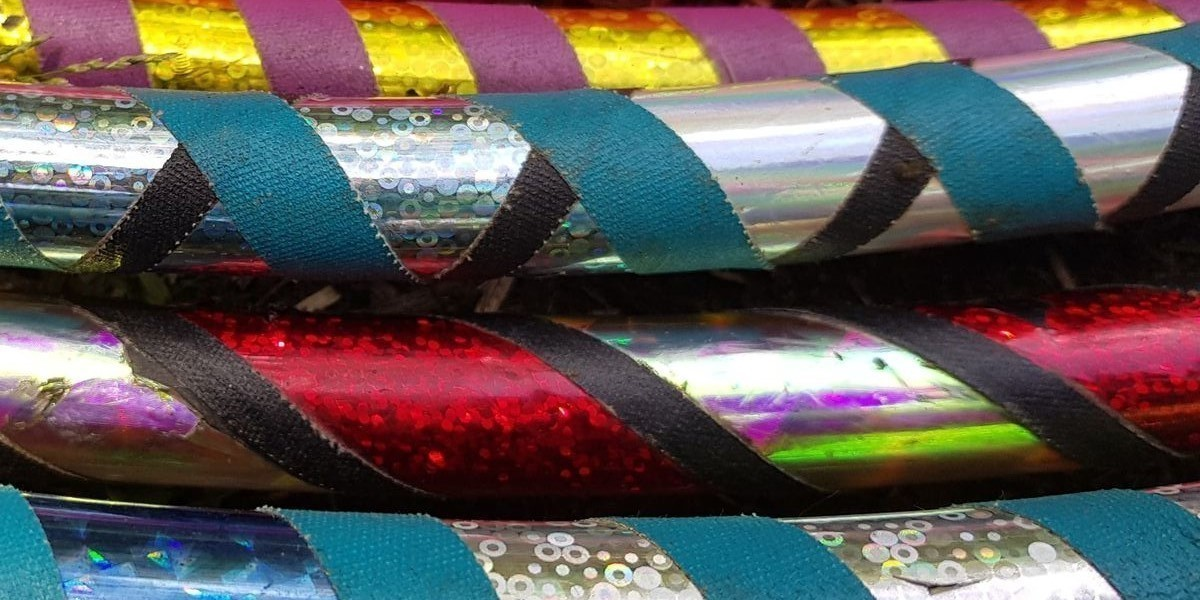 A close up photograph of the side four hula hoops. They have been covered with different coloured wrapping.